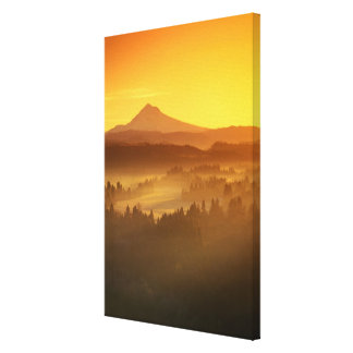 Sunrise orange colors the fog in the valley in canvas print