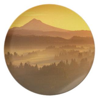 Sunrise orange colors the fog in the valley in melamine plate