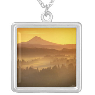 Sunrise orange colors the fog in the valley in silver plated necklace