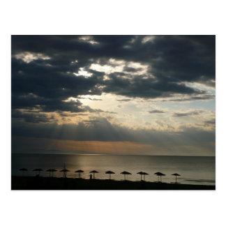 Sunrise over beach in Greece postcard