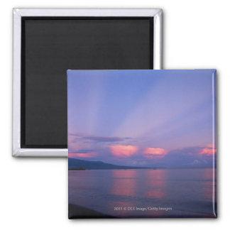 Sunrise over sea refrigerator magnet