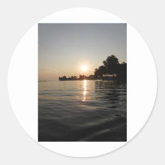 Sunrise over soft water classic round sticker