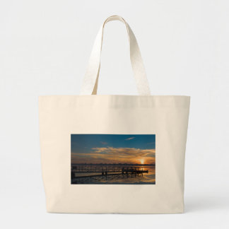Sunrise over the jetty large tote bag