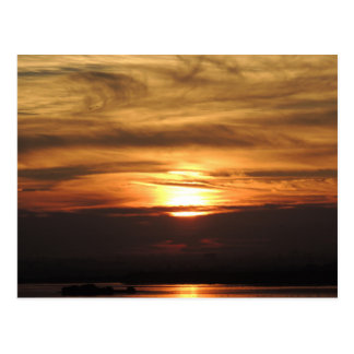 Sunrise over water gold and russet postcard