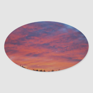 Sunrise through stars, dreaming oval sticker