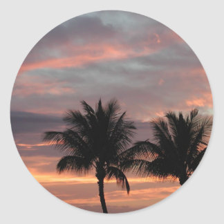 Sunset and palm trees classic round sticker