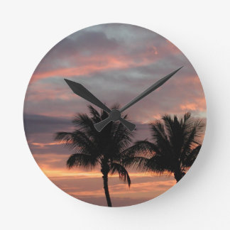 Sunset and palm trees round clock