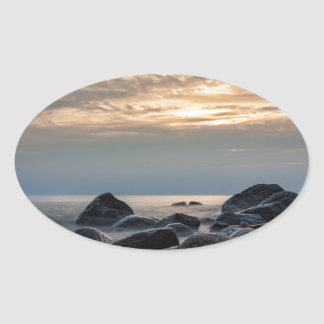 Sunset and stones on the Baltic Sea coast Oval Sticker