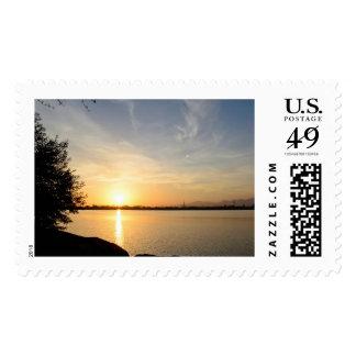 Sunset at lake stamp