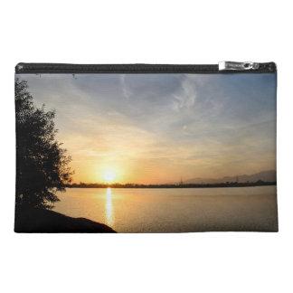 Sunset at lake travel accessory bag