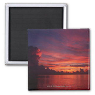 Sunset at sea with dark clouds fridge magnets
