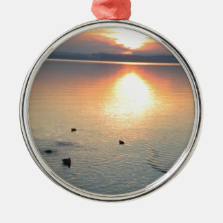 Sunset at the lake with ducks metal ornament
