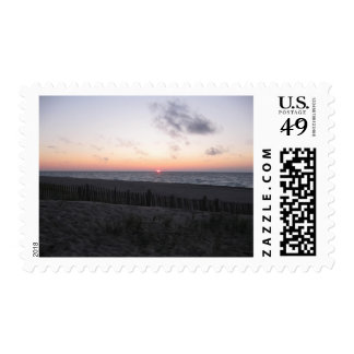 sunset at two-hearted lake michigan stamps