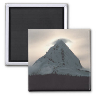 Sunset behind a snowy mountain 2 inch square magnet