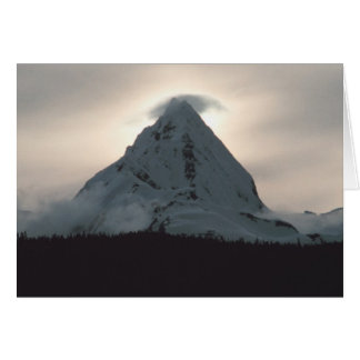 Sunset behind a snowy mountain card