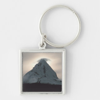 Sunset behind a snowy mountain keychain