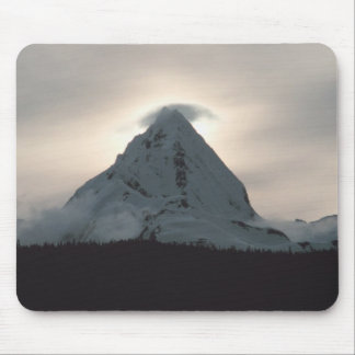 Sunset behind a snowy mountain mouse pad