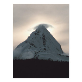 Sunset behind a snowy mountain postcard