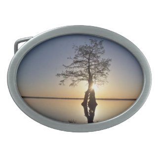 Sunset Behind a Tree Oval Belt Buckles
