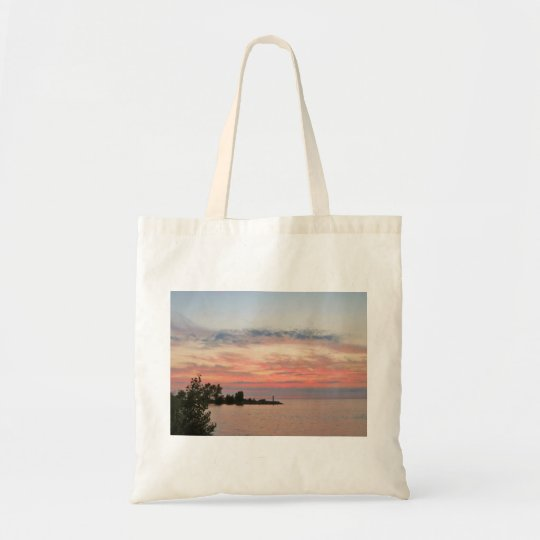 Sunset Behind Clouds by the Lake Tote Bag