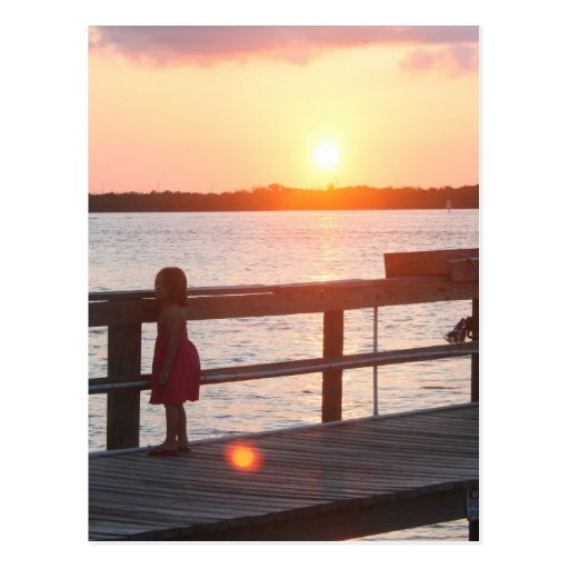 Sunset behind dock in Florida with little girl Post Cards