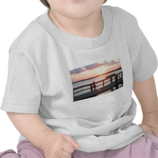 Sunset behind dock in Florida with little girl T-shirt