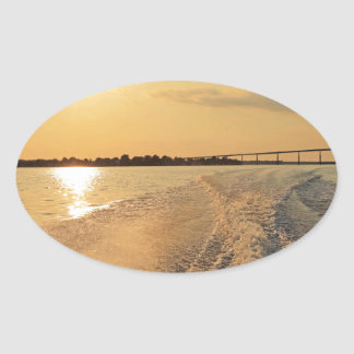 Sunset Boat Ride Oval Sticker