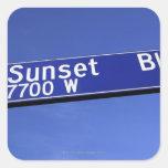Sunset Boulevard sign against a blue sky Square Sticker