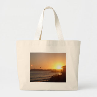 Sunset by the lighthouse large tote bag