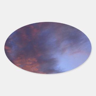 Sunset clouds oval sticker