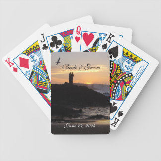 Sunset couple playing cards