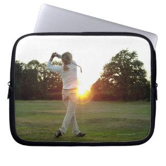 Sunset golf swing laptop sleeve