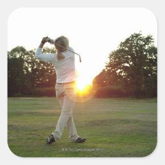 Sunset golf swing square sticker