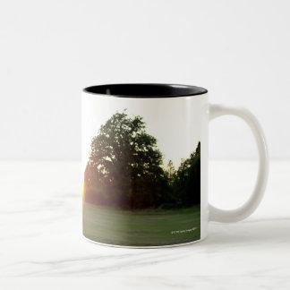 Sunset golf swing Two-Tone coffee mug