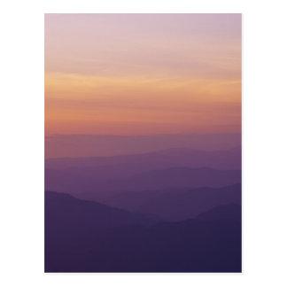 Sunset hilly landscape postcard