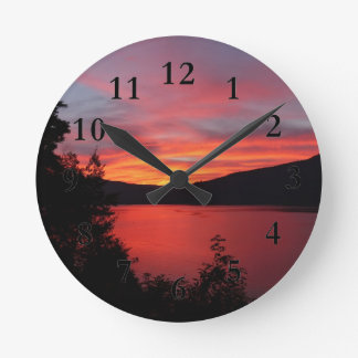 Sunset in Lake and mountain views Round Clock