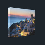 """Sunset in Oia Greece Canvas Print<br><div class=""""desc"""">Opa!  As the sun goes down everyone yells &quot;Opa!&quot; in Oia,  Santorini,  Greece.  Sunsets are magical in Oia and the small town glows like a Christmas village.</div>"""