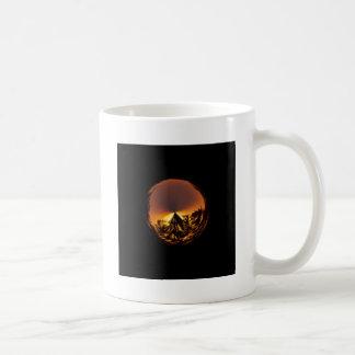 Sunset in the globe coffee mug