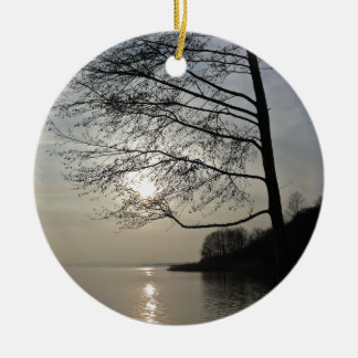 Sunset in the winter tree at the lake ceramic ornament