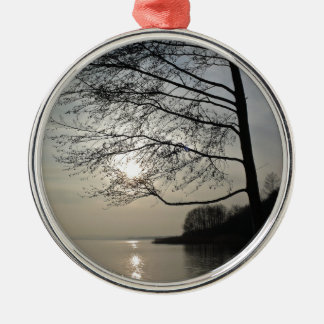 Sunset in the winter tree at the lake metal ornament