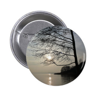 Sunset in the winter tree at the lake pinback button