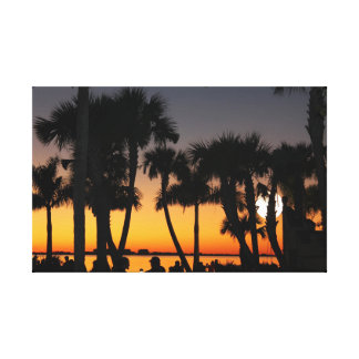 Sunset moonrise beyond the palm trees canvas print