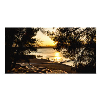 Sunset on a picnic area next to a lake card