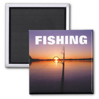 Sunset on a summer lake seen through a fishing rod magnet