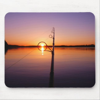 Sunset on a summer lake seen through a fishing rod mouse pad