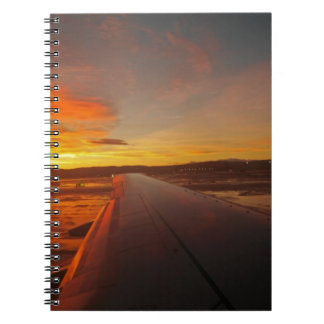 Sunset on Airplane wing Notebook