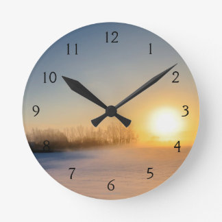 Sunset on Christmas Day in countryside Round Clock