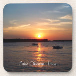 "Sunset on Lake Okoboji, Iowa Drink Coaster<br><div class=""desc"">This drink coaster features a photo of the sun setting on West Lake Okoboji. The photo is accented with a silhouette of several boat crossing the lake.</div>"
