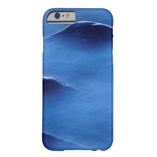 Sunset on rocks protruding through foamy water barely there iPhone 6 case