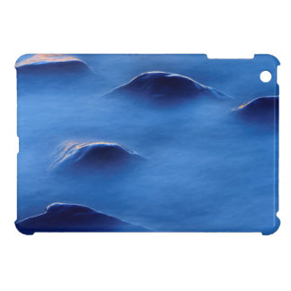 Sunset on rocks protruding through foamy water iPad mini covers